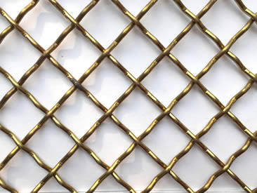 A piece of brass crimped woven mesh with square holes.