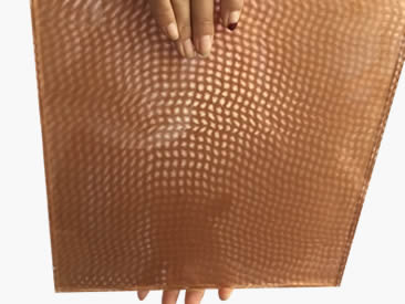 A person is holding a laminated glass metal mesh. And the metal mesh with leaf picture is made of fine woven wire mesh.