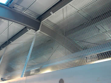 Silver white architectural rope mesh used in airport as stair balustrade.