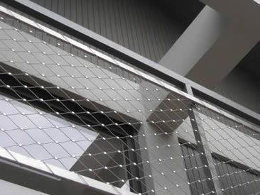 Corridor balustrade is made of silver white architectural rope mesh.