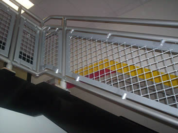 White stainless steel woven wire mesh is used as stair balustrade.