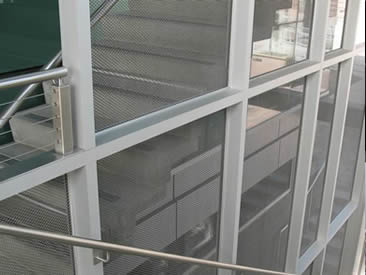 Woven wire mesh is made of fine wire used as stair railing.