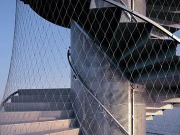 Silver white architectural rope mesh is used in unique architecture as protection.