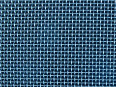 Blue galvanized architectural woven mesh made of fine wire mesh.