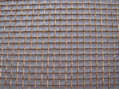 Architectural woven mesh made of copper.