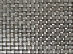 A woven wire mesh made of flat aluminum wire.