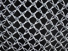 A galvanized honeycomb wire mesh.